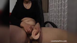 Mature lady uses a vibrator and rubs her shaved pussy